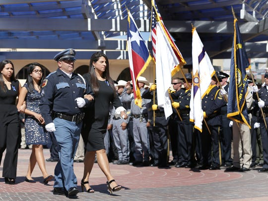 Carmen East is escorted into the Abraham Chavez Theatre