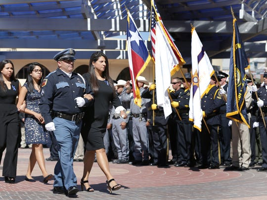 Carmen East is escorted into the Abraham Chavez Theatre on Tuesday for a memorial service for her husband, Texas Tech University police Officer Floyd East Jr.
