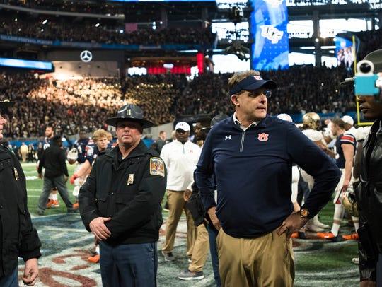 Auburn head coach Gus Malzahn looks on after UCF defeated