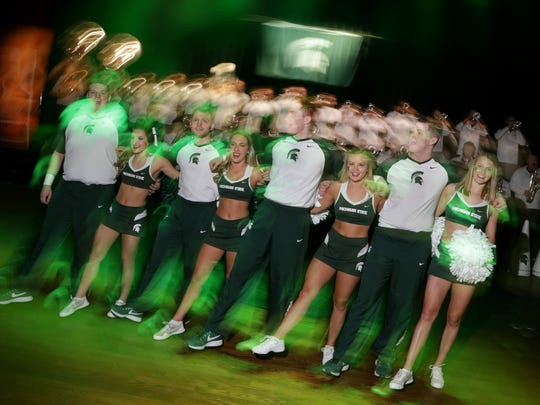 Michigan State University Cheer and Dance team performs during a pep rally with Michigan State alumni and fans at the Fillmore Detroit in Detroit on Friday, March 16, 2018.