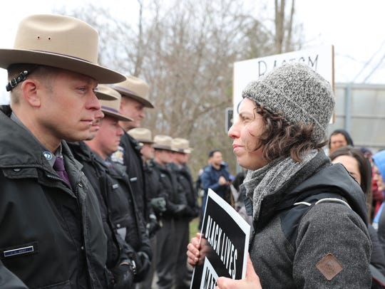 Anna Adler from Cold Spring, right confronts New York