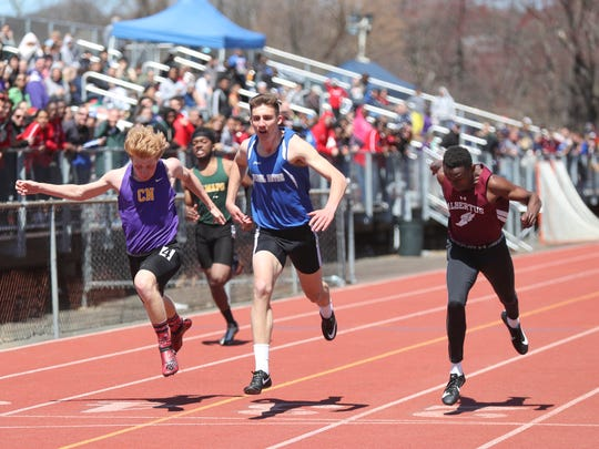 Thomas Wilson wins the 200-meter dash during day 2