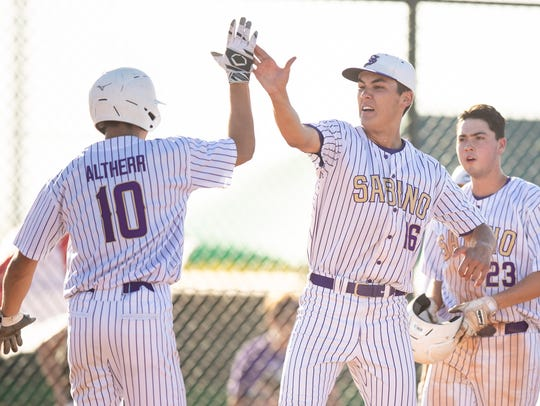 Junior left-handed pitcher Andrew Calloway (16) (R)and
