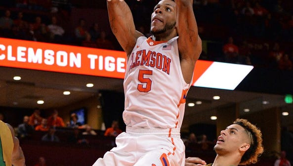 Clemson's Jaron Blossomgame scores two of his 30 points
