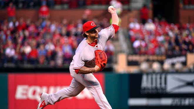 Cincinnati Reds starting pitcher Brandon Finnegan (29) pitches during the first inning against the St. Louis Cardinals at Busch Stadium.