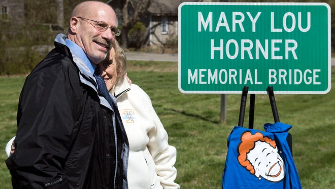 Bobby Horner, son of Mary Lou Horner, is hugged by Betty Lane during bridge dedication ceremony in memory of the late Mary Lou Horner at Fair Havens Baptist Church on Thursday, March 22, 2018. Lane was a close friend and also treasurer for Horner during her campaigns for Knox County Commission.