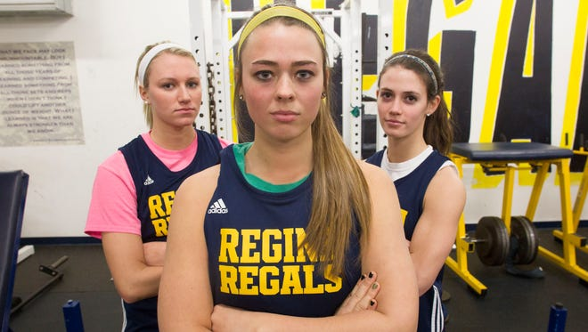 From left, Regina's Kennedy Brown, Hannah Stein, and Cammy Verducci pose for a photo on Thursday. The Regals are back in the state tournament for the second time in three seasons.