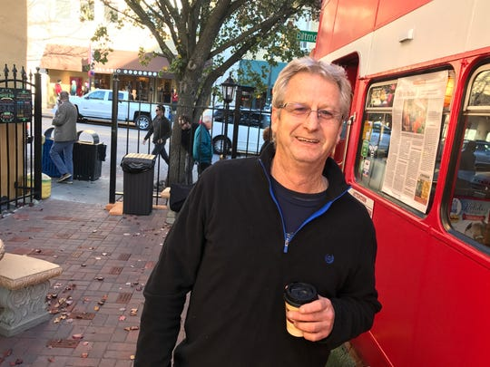 """Jeff Lazzaro, who owns Double D's Coffee & Desserts with his wife, Karen, said they wanted to create a """"readable patio"""" when they renovated the outdoor seating area at the double decker bus."""