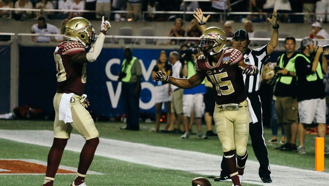 Travis Rudolph (15) and Nyqwan Murray (80) celebrate a second quarter touchdown at Camping World Stadium in Orlando, FSU topped the Ole Miss Rebels 45-34.