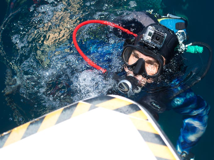 """Dave Mucci returns to dive boat H20 Below after taking the plunge on the S.S. San Pablo, also commonly know as the """"Russian Freighter"""" in the Gulf of Mexico Wednesday Aug. 6, 2014. A group of dignitaries took part in a venture to highlight the promotional launch of dive tourism, """"Beyond Beaches"""" of Florida's Panhandle. Sec. of State Ken Detzner will be in town promoting the Florida Panhandle Shipwreck Trail on Wednesday by taking a boatload of industry journalist and other divers to the San Pablo shipwreck site off of Pensacola."""