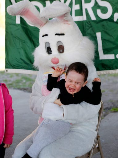 Chris Mezquida, 18-months-old, cries while posing for a photo with the Easter Bunny during the annual Police Athletic League Easter egg hunt at Redmond Field, April 19, 2014 in Yonkers.