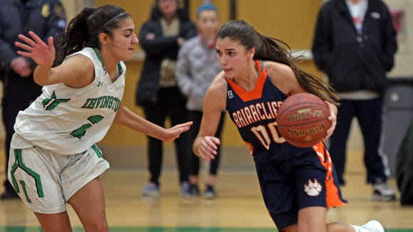 Briarcliff's Kacey Hamlin (00) dribbles around Irvington's Olivia Valdes (2) during girls basketball game at Irvington High School on Dec. 14, 2016. Irvington defeats Briarcliff 65-36.