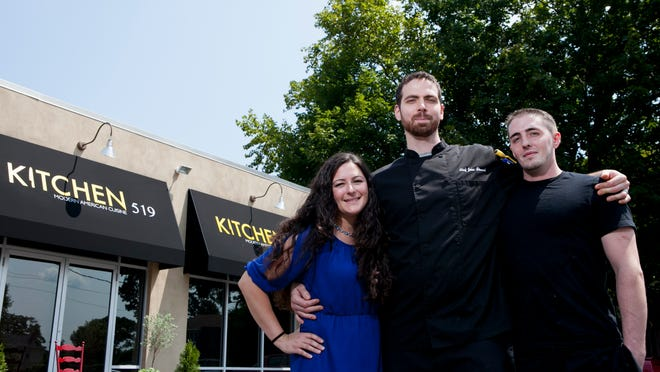 John Stewart, his wife, Diana and sous chef Michael Twaddell pose for a portrait at their restaurant Kitchen 519, Thursday, August 7, 2014 in Glendora.