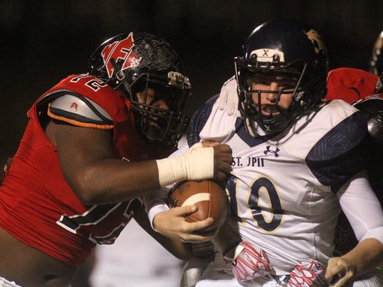 St. John Paul II quarterback Brian Woodend is taken