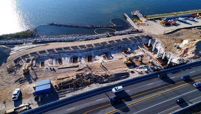 A look down on U.S. 98 near the foot of the existing Pensacola Bay Bridge in Gulf Breeze, where crews are building the approach for the new bridge. The rectangles near the center are the foundations for the future retaining wall. Visible on the right are the piles that mark the eastern end of the bridge.