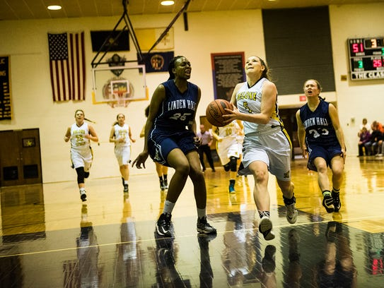 Delone's Lilly Singleton drives the ball for a layup