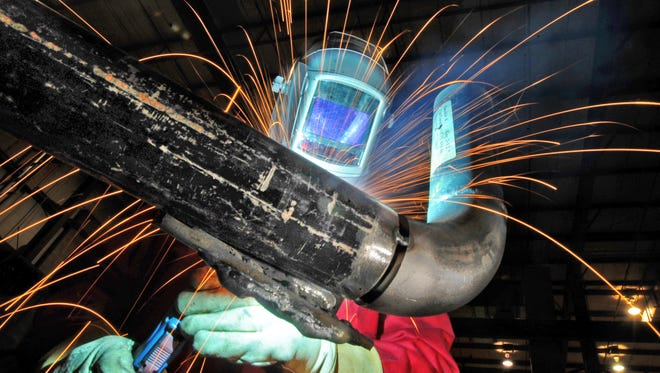 Todd Hidde, shop superintendent, performs a MIG weld at J. F. Ahern Co., 855 Morris St., in Fond du Lac, Friday, Jan. 16, 2008.