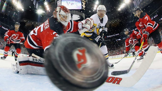 Patric Hornqvist of the Pittsburgh Penguins scores on the power play against the New Jersey Devils.