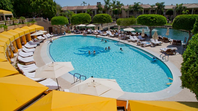 """The """"Mother of Pearl"""" pool is one of nine at the Phoenician resort. The resort's logo is inlaid in the center with iridescent mother of pearl tiles."""