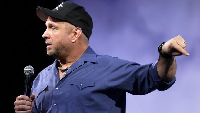 Garth Brooks speaks at a news conference on  July 10 in Nashville.
