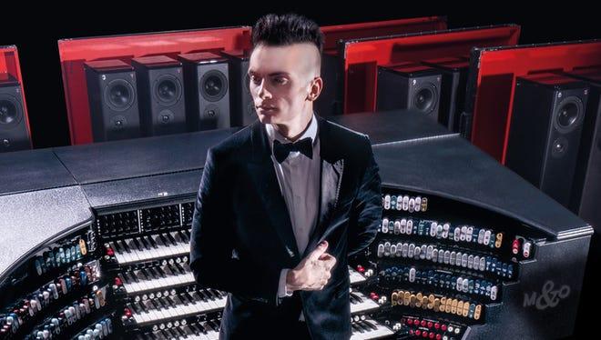 Cameron Carpenter and his custom-built digital touring organ.