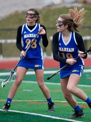 Lauren Cosgrove (19) and Marian teammate Tessa Glod go on the attack in Thursday's game against Bloomfield Hills.