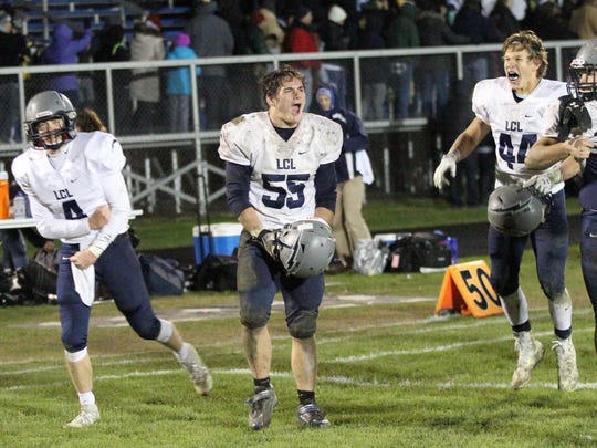 Lake Country Lutheran players (from left) Ethan Wilkins (4), Isaac Simons (55), Jack Levrerenz (44), Noah Vanderberg (65), and RJ Ferrking (77) celebrate the LCL win in Level 3 of the playoffs over Clinton on Nov. 3, 2017.