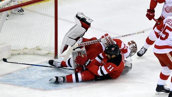 New Jersey Devils center Brian Boyle (11) collides