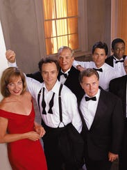 "The cast members of the NBC series ""The West Wing."""