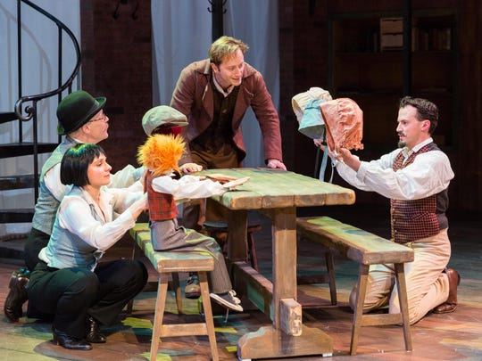 """From left, Betsy Rosen, Michael Boudewyns, Jeffrey Hawkins as Bob Cratchit and John Plumpis in Delaware Theatre Company's """"A Christmas Carol."""""""