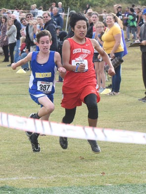 Ky Bickford edges past a Green Forest runner at the