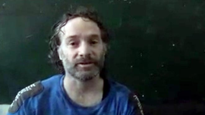 Peter Theo Curtis, a U.S. citizen held hostage by an al-Qaeda-linked group in Syria, delivers a statement.