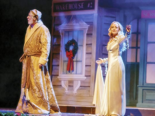 """Paris Peet as Ebenezer Scrooge and Whitney Meyer as the Spirit of Christmas Past in Totem Pole Playhouse's new adaptation of Dickens' """"A Christmas Carol,"""" coming Dec. 9-20 to the Majestic Theater in Gettysburg."""