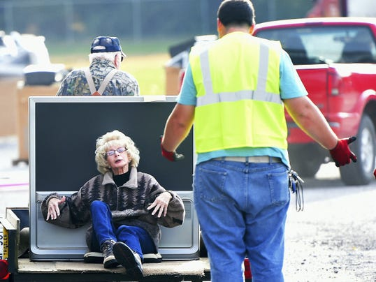 Wilda Shoop, Shippensburg, is carted in, along with an old TV, to Southampton Township's regional electronic recycling collection event on Saturday. Shoop was not, however, left with the old monitors, keyboards and other electronics.