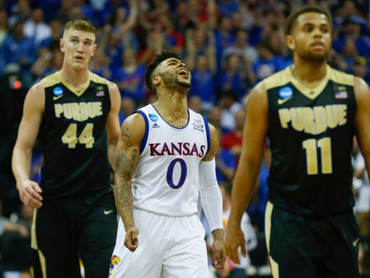 Kansas guard Frank Mason III (0) reacts during the