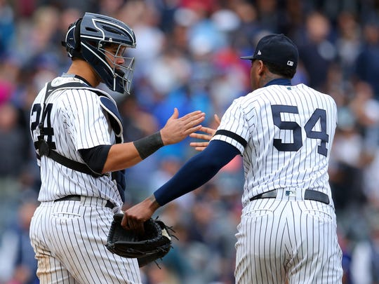 New York Yankees catcher Gary Sanchez (24) and New York Yankees relief pitcher Aroldis Chapman (54) celebrate after defeating the Toronto Blue Jays at Yankee Stadium on Saturday, Sept. 30, 2017.