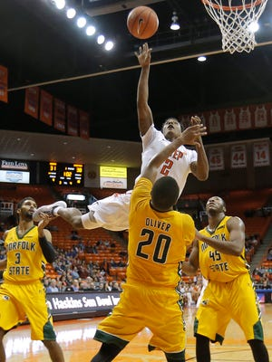UTEP guard Omega Harris collides with Norfolk State's Charles Oliver during their first-round game Monday in the WestStar Bank Don Haskins Sun Bowl Invitational.