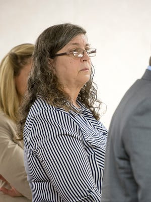 Milton day care provider Thelma Lowery stands as the jury enters the room during her trial in the Santa Rosa Courthouse in Milton on Tuesday, August 8, 2017.  Lowery is charged with allegedly killing a 15-month-old in her care.
