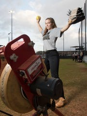 Senior pitcher Megan Robertson poses on the softball field at Milton High School on Thursday, February 15, 2018.  Robertson has signed to play with the University of Arkansas next year.