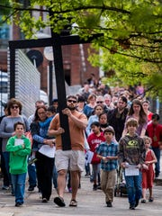 Parishioners take part in Way of The Cross on Good
