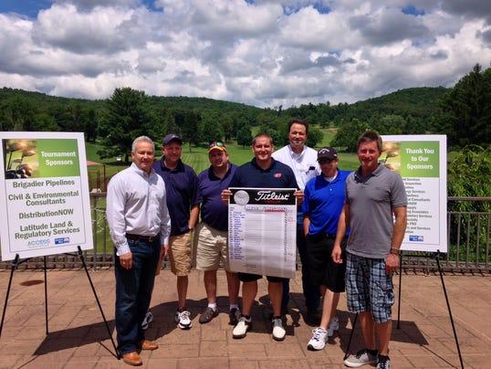 ELM 073114 golf donation prov.JPG