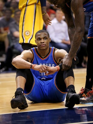 A dejected Oklahoma City Thunder guard Russell Westbrook (0) sits on the floor late in the second half of their game Sunday, April 12, 2015 evening at Bankers Life Fieldhouse. The Pacers defeated the Thunder 116-104.