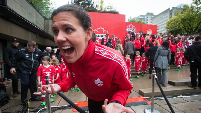 Canadian national women's soccer team captain Christine Sinclair  jokes with her niece after the roster for the 2015 FIFA Women's World Cup was announced in Vancouver. Sinclair is doubling as both striker and ambassador for Canada when her native country hosts the Women's World Cup starting in June. No doubt there's mounting pressure, but so far Sinclair isn't letting it get to her.
