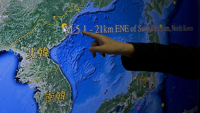 Kuo Kai-wen, director of Taiwan's Seismology Center, points at the locations from a monitor showing North Korea's first hydrogen bomb test site, in Taipei on Jan. 6, 2016.