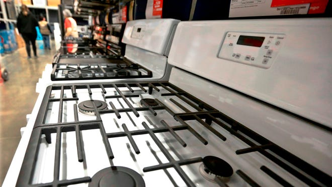 A customer looks over a selection of stoves that are available for sale at a big box store in Cranberry Township, Pa. On Thursday, April 26, the Commerce Department releases its March report on durable goods.