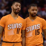 Phoenix Suns forwards Markieff Morris (11) and Marcus Morris talk during a time-out against the Portland Trail Blazers.