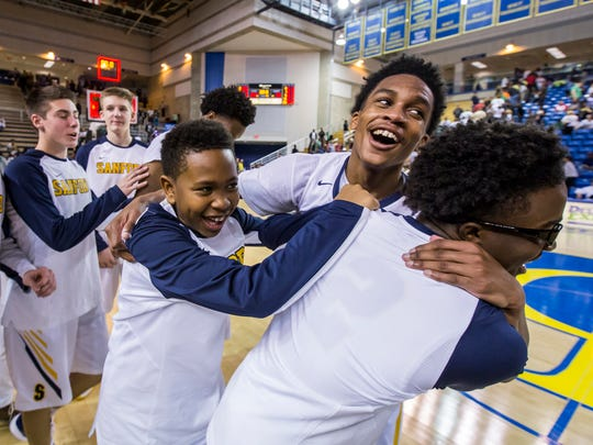 Sanford players celebrate following their 38-30 win over Mt. Pleasant in their DIAA State Basketball Tournament semi-final game at the Bob Carpenter Center in Newark on Thursday night.