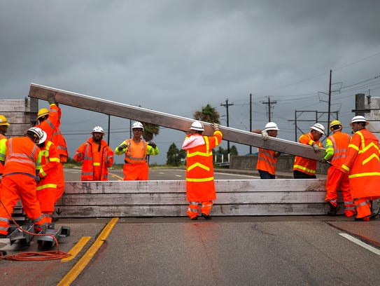 TxDOT crews install the final portion of a surge wall