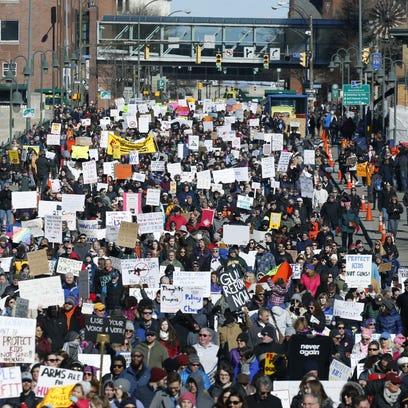 A huge crowd marches across the Court Street  bridge