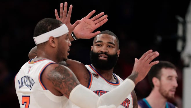 New York Knicks center Kyle O'Quinn (9) congratulates forward Carmelo Anthony (7), who hit the game-winning shot to lead the Knicks past the Hornets, Friday, Nov. 25, 2016, in New York. (AP Photo/Julie Jacobson)